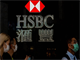 HSBC looks to Asia after profits plunge 34%