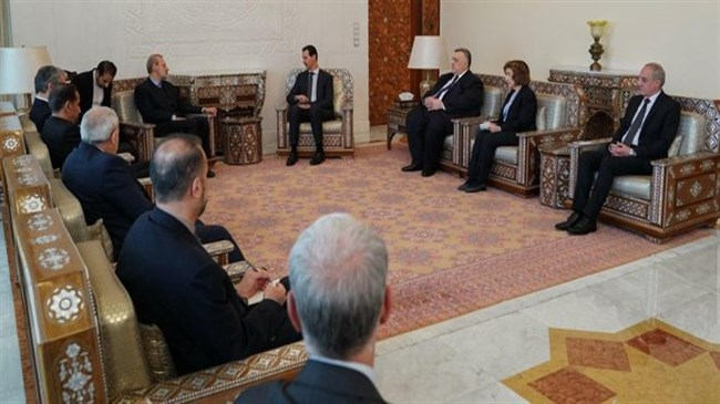 Assad meets Larijani, says enemies still trying to protect terrorists