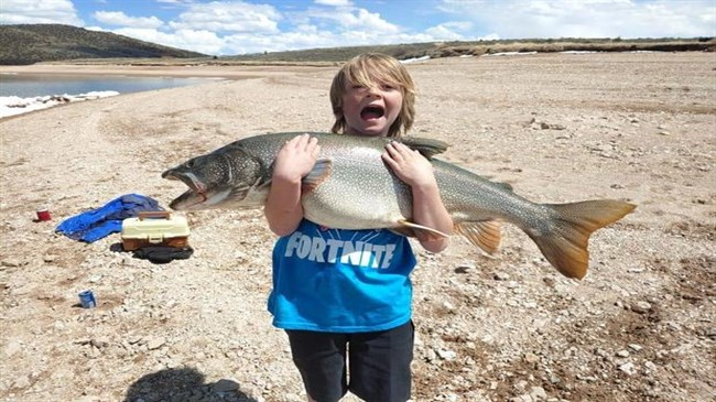11-year-old Colorado boy catches trout the size of a toddler