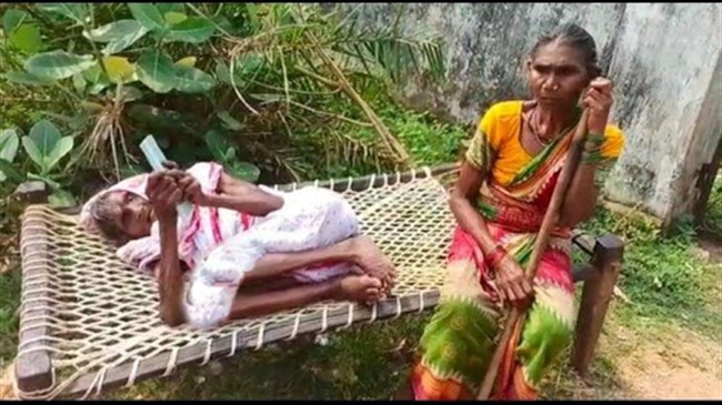 Elderly woman drags cot with 120-year-old bedridden mother to withdraw pension from bank