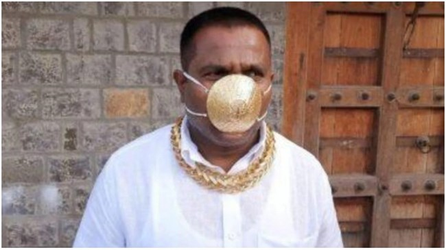 Indian man wears gold mask to protect himself from coronavirus