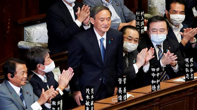 Japan's Suga voted PM, crafts 'continuity cabinet'